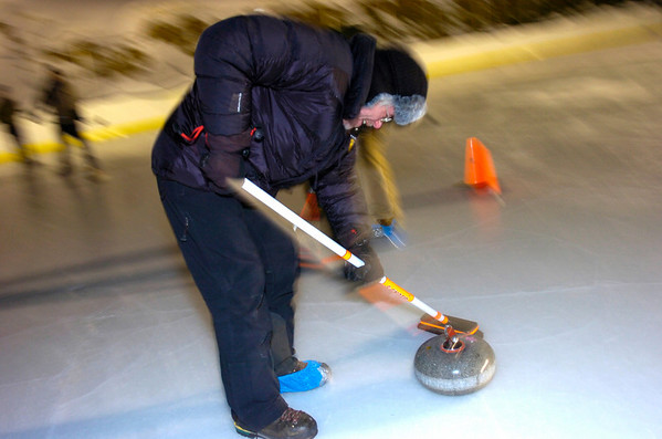 "Steve Cser sweeps in front of a rock during play of the Nederland Curling Club at the NedRINK - Nederland Ice & Racquet Park on Monday February 15, 2010.<br /> Photo by Paul Aiken / The Camera<br /> Watch a video and see more photos of the Nederland Curling Club at  <a href=""http://www.dailycamera.com"">http://www.dailycamera.com</a>"