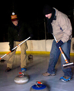 Doug Jones and Matt Flynn sweep in front of a rock during play of the Nederland Curling Club at the NedRINK - Nederland Ice & Racquet Park on Monday February 15, 2010. Photo by Paul Aiken / The Camera Watch a video fo the Nederland Curling Club at www.dailycamera.com