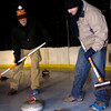 "Doug Jones and Matt Flynn sweep in front of a rock during play of the Nederland Curling Club at the NedRINK - Nederland Ice & Racquet Park on Monday February 15, 2010.<br /> Photo by Paul Aiken / The Camera<br /> Watch a video fo the Nederland Curling Club at  <a href=""http://www.dailycamera.com"">http://www.dailycamera.com</a>"