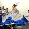 "Theater- Nutcracker32.JPG Laurie Clark, playing the cook in the large dress, is getting help with the costume during  rehearsal for ""The Nutcracker.""<br /> The Boulder Ballet Company is performing ""The Nutcracker.""<br /> Cliff Grassmick / November 19, 2011"
