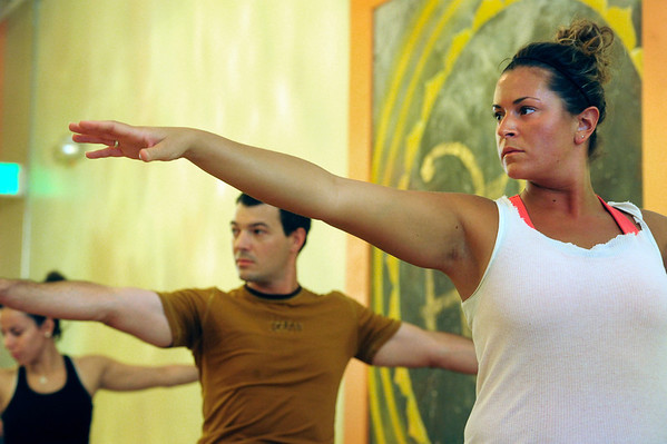 YOGA03.JPG YOGA<br /> Seva Kouremetis, right, takes a yoga class at Om Time in Boulder. At center is Chad Fatino; at left is Raquel Mayorga.<br /> Photo by Marty Caivano/July 8, 2011