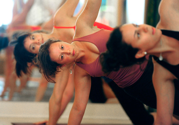 YOGA08.JPG YOGA<br /> Lindsay Leboyer, center, takes a yoga class at Om Time in Boulder. At left is Trina Grant; at right is Raquel Mayorga.<br /> Photo by Marty Caivano/July 8, 2011