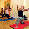 YOGA07.JPG YOGA<br /> Lauri Beckwith, right, takes a yoga class at Om Time in Boulder. From left are Raquel Mayorga, Chad Fatino and Seva Kouremetis.<br /> Photo by Marty Caivano/July 8, 2011