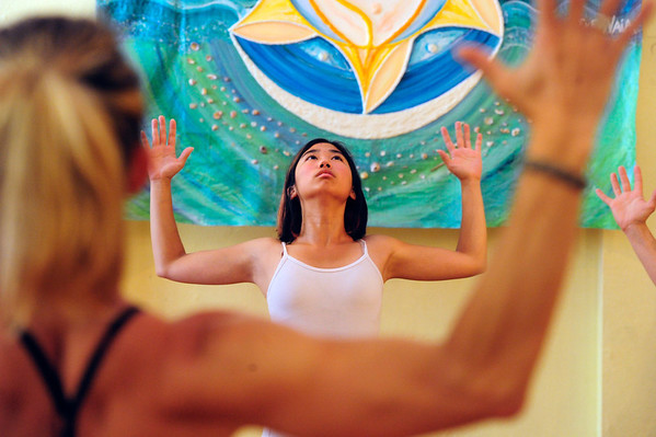 YOGA01.JPG YOGA<br /> Keli Sakamoto takes a yoga class at Om Time in Boulder.<br /> Photo by Marty Caivano/July 8, 2011