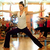 YOGA04.JPG YOGA<br /> Kate Sciolino teaches a yoga class at Om Time in Boulder. <br /> Photo by Marty Caivano/July 8, 2011