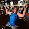 _DSC2117.JPG Clint Findley works with a pull down bar during his after work workout in the gym at Intrado in Longmont on Monday September 10, 2012. Findley has lost around 50lbs with a combination of diet and exercise.<br /> Photo by Paul Aiken / The Boulder Daily Camera