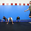 20120206_CROSSFIT_WARMUP.jpg Michael Feldpusch, right, jumps rope during warm-up rotations for a CrossFit class, while Beth Mortell, left, Dave Mortell, Jamie Scotto, and Jane Davis do planks beside him. CrossFit in Louisville, Colo. offers 40 classes per week in which athletes of all levels train alongside eachother, Monday, Feb. 6, 2012. (Morgan Varon)