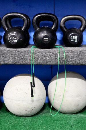 20120206_CROSSFIT_KETTLEBELL.jpg Kettlebells and concerete balls are some of the exercise equipment used at CrossFit in Louisville, Colo. on Monday, Feb. 6, 2012. (Morgan Varon)