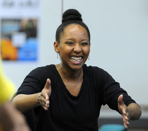"Instructor Jennifer Johnson tells a funny story while teaching the class on Wednesday.<br /> The Parkinson's Association of the Rockies holds weekly dance classes to help people manage their symptoms.<br /> For more photos and a video the dance class, go to  <a href=""http://www.Broomfieldenterprise.com"">http://www.Broomfieldenterprise.com</a>.<br />  Cliff Grassmick / May 2, 2012"
