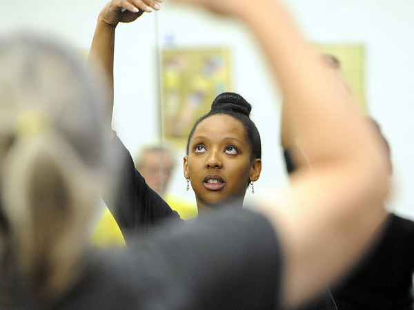 """Instructor Jennifer Johnson helps clients with their range of motion during the class on Wednesday.<br /> The Parkinson's Association of the Rockies holds weekly dance classes to help people manage their symptoms.<br /> For more photos and a video the dance class, go to  <a href=""""http://www.Broomfieldenterprise.com"""">http://www.Broomfieldenterprise.com</a>.<br />  Cliff Grassmick / May 2, 2012"""
