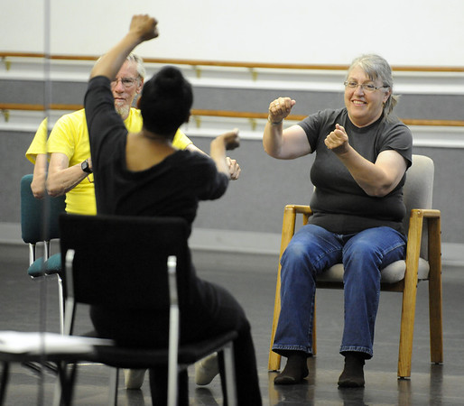 "Instructor Jennifer Johnson helps clients with their range of motion by simulating driving a car during the class on Wednesday. Cliff  Rullman and his wife, Laurel, follow instructions.<br /> The Parkinson's Association of the Rockies holds weekly dance classes to help people manage their symptoms.<br /> For more photos and a video the dance class, go to  <a href=""http://www.Broomfieldenterprise.com"">http://www.Broomfieldenterprise.com</a>.<br />  Cliff Grassmick / May 2, 2012"