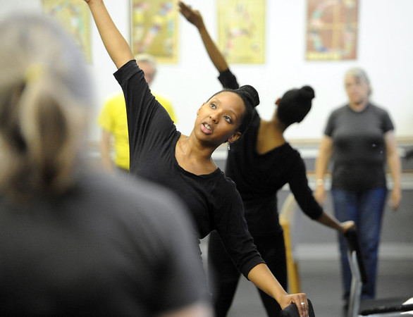 """Instructor Jennifer Johnson helps clients with their range of motion during the class on Wednesday.The Parkinson's Association of the Rockies holds weekly dance classes to help people manage their symptoms.<br /> For more photos and a video the dance class, go to  <a href=""""http://www.Broomfieldenterprise.com"""">http://www.Broomfieldenterprise.com</a>.<br />  Cliff Grassmick / May 2, 2012"""