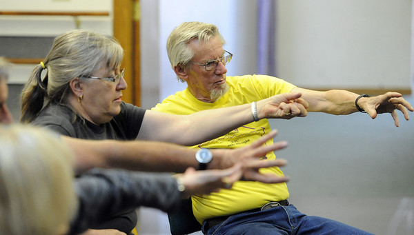 "Laurel Rullman, and husband, Cliff, follow the instructor's lead to help with their range of motion.<br /> The Parkinson's Association of the Rockies holds weekly dance classes to help people manage their symptoms.<br /> For more photos and a video the dance class, go to  <a href=""http://www.Broomfieldenterprise.com"">http://www.Broomfieldenterprise.com</a>.<br />  Cliff Grassmick / May 2, 2012"