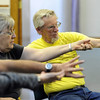 """Laurel Rullman, and husband, Cliff, follow the instructor's lead to help with their range of motion.<br /> The Parkinson's Association of the Rockies holds weekly dance classes to help people manage their symptoms.<br /> For more photos and a video the dance class, go to  <a href=""""http://www.Broomfieldenterprise.com"""">http://www.Broomfieldenterprise.com</a>.<br />  Cliff Grassmick / May 2, 2012"""