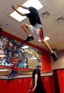 Daytovio Boatner jumps from locker to locker inside Fairview High School during the Parkour Club workout. For more photos of the Parkour, go to www.dailycamera.com. Cliff Grassmick/ January 29, 2010