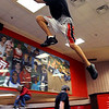 "Daytovio Boatner jumps from locker to locker inside Fairview High School during the Parkour Club workout.<br /> For more photos of the Parkour, go to  <a href=""http://www.dailycamera.com"">http://www.dailycamera.com</a>.<br /> Cliff Grassmick/ January 29, 2010"