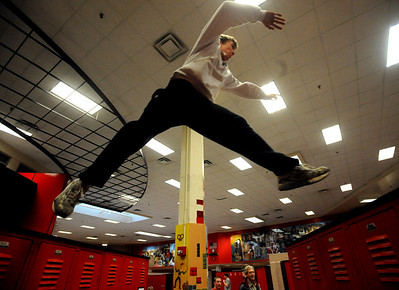 Levi Satter jumps from locker to locker inside Fairview High School during a Fairview Club Parkour workout. For more photos of the Parkour, go to www.dailycamera.com. Cliff Grassmick/ January 29, 2010