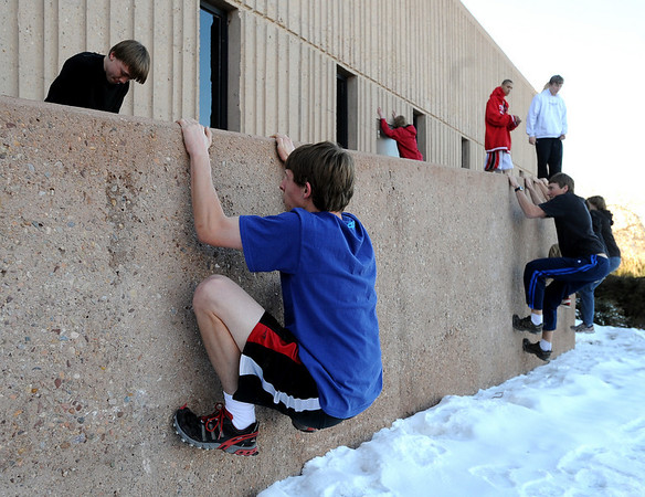 "George Grell, bottom left, joins other members of the Fairview Parkour Club, move down the walk way walls outside the school.<br /> For more photos of the Parkour, go to  <a href=""http://www.dailycamera.com"">http://www.dailycamera.com</a>.<br /> Cliff Grassmick/ January 29, 2010"