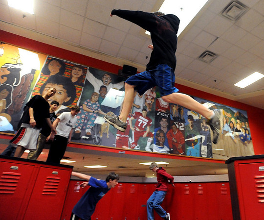 "Jack Ryden jumps from locker to locker inside Fairview High School during the Fairview Parkour Club workout.<br /> For more photos of the Parkour, go to  <a href=""http://www.dailycamera.com"">http://www.dailycamera.com</a>.<br /> Cliff Grassmick/ January 29, 2010"