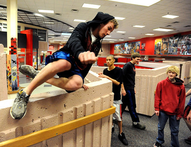 Jack Ryden jumps over a wall  as other members look on inside Fairview High School during the Fairview Parkour Club workout. For more photos of the Parkour, go to www.dailycamera.com. Cliff Grassmick/ January 29, 2010