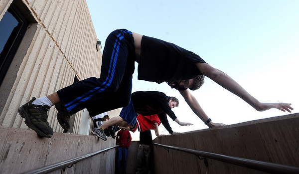 "Colin Bovet, top, and other members of the Fairview Parkour Club work their way down a walk way outside the school.<br /> For more photos of the Parkour, go to  <a href=""http://www.dailycamera.com"">http://www.dailycamera.com</a>.<br /> Cliff Grassmick/ January 29, 2010"