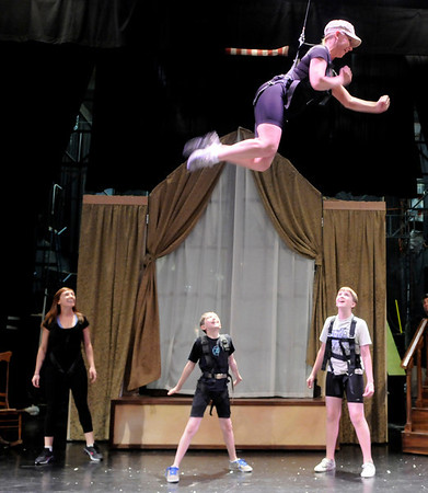 "Ellen Kaye, left, John Hanson, and Joe Connors, watch as Joanie Beyette flys above them during a rehearsal for Peter Pan at the Boulder Dinner Theatre on May 6, 2010. For a video of the actors in flight and a photo gallery, visit  <a href=""http://www.dailycamera.com"">http://www.dailycamera.com</a><br /> Stephen Swofford / Daily Camera"