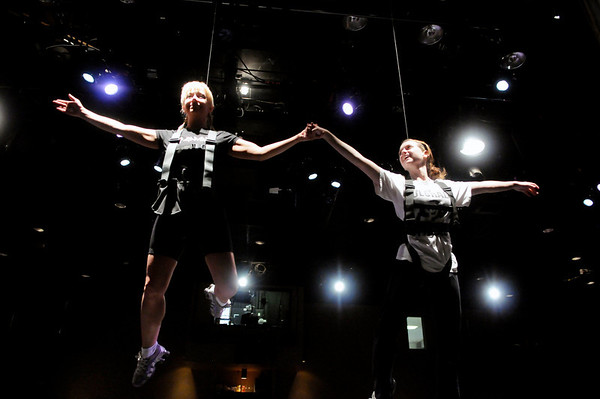 "Joanie Beyette, left, and Sarah Finnegan practice a scene mid-air during a rehearsal for Peter Pan at the Boulder Dinner Theatre on May 6, 2010. For a video of the actors in flight and a photo gallery, visit  <a href=""http://www.dailycamera.com"">http://www.dailycamera.com</a><br /> Stephen Swofford / Daily Camera"