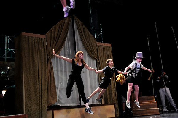 """Ellen Kaye, left, John Hanson, and Joe Connors, rehearse a flying scene during a rehearsal for Peter Pan at the Boulder Dinner Theatre on May 6, 2010. For a video of the actors in flight and a photo gallery, visit  <a href=""""http://www.dailycamera.com"""">http://www.dailycamera.com</a><br /> Stephen Swofford / Daily Camera"""