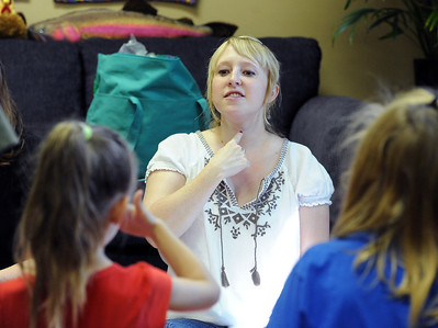 Instructor, Stacia Synnestvedt, points out the seven chakras on the body to her students. Psychic courses for children focus on giving children the tools to learn to stay connected to their inner knowing, understand their personal space and help them connect to what is true and important for them. For more photos, go to www.dailycamera.com. Cliff Grassmick / July 21, 2012