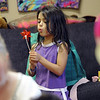 "Cali Hernandez blows a pin wheel during her psychic class.<br /> Psychic courses for children focus on giving children the tools to learn to stay connected to their inner knowing, understand their personal space and help them connect to what is true and important for them.<br /> For more photos, go to  <a href=""http://www.dailycamera.com"">http://www.dailycamera.com</a>.<br /> Cliff Grassmick / July 21, 2012"