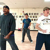From left to right De Thomas, Choreographer Matthew D. Peters, and Brian Jackson work on some dance move for Boulder's Dinner Theatre  production of SWING! during practice at the Rocky Mountain Theatre For Kids in Boulder on Wednesday February 16, 2011.<br /> Photo by Paul Aiken /