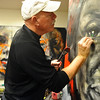 BRAINART<br /> William Stoehr works on details around the eyes of one of his portraits.<br /> Photo by Marty Caivano/Camera/Nov. 9, 2010
