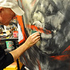 BRAINART<br /> William Stoehr uses a sponge to create texture while working on one of his paintings.<br /> Photo by Marty Caivano/Camera/Nov. 9, 2010