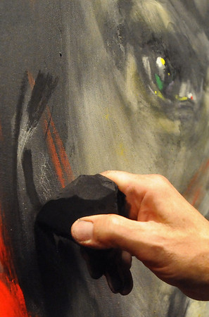 BRAINART<br /> William Stoehr uses a block of charcoal on one of his paintings.<br /> Photo by Marty Caivano/Camera/Nov. 9, 2010