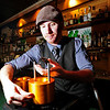 DRINKS<br /> Mark Stoddard, bar manager at The Bitter Bar, removes an ice sphere from its shaping device.<br /> Photo by Marty Caivano/May 9, 2011