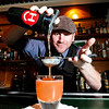DRINKS<br /> Mark Stoddard, bar manager at The Bitter Bar, makes a Mexican Firing Squad, which includes Corrido silver tequila, pomegranate juice, aromatic bitters, ginger beer and fresh lime juice.<br /> Photo by Marty Caivano/May 9, 2011