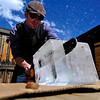DRINKS<br /> Mark Stoddard, bar manager at The Bitter Bar, uses a chainsaw to cut through sculpture ice so he can reduce it to ice spheres.<br /> Photo by Marty Caivano/May 9, 2011