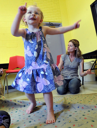 "Sophie Ewalt dances to one of the songs French teacher Veronique Carney is singing in the background.<br /> For more photos and a video of the language class, go to  <a href=""http://www.dailycamera.com"">http://www.dailycamera.com</a><br /> Cliff Grassmick / April 25, 2012"