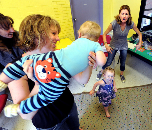 "Jennie Ewalt plays airplane with her son, Daniel, as her daughter, Sophie, dances below, as French teacher, Veronique Carney sings a song at the top right.<br /> For more photos and a video of the language class, go to  <a href=""http://www.dailycamera.com"">http://www.dailycamera.com</a><br /> Cliff Grassmick / April 25, 2012"