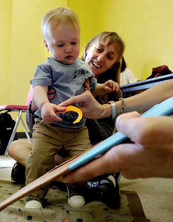 "Amy Giaquinto watches her son, Gabriel, 15-months, put a dinosaur on the board after getting instruction in French.<br /> For more photos and a video of the language class, go to  <a href=""http://www.dailycamera.com"">http://www.dailycamera.com</a><br /> Cliff Grassmick / April 25, 2012"