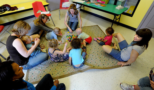 "French teacher, Veronique Carney,  top center, plays a game with the class at the WOW Children's Museum in Lafayette. Her class includes Amy Giaquinto and Gabriel, next to Carney, the clockwise, Jennie Ewalt with son, Daniel, and daughter, Sophie, Arabella Snyder, Lea Sidibe, with daughter, Sira. <br /> For more photos and a video of the language class, go to  <a href=""http://www.dailycamera.com"">http://www.dailycamera.com</a><br /> Cliff Grassmick / April 25, 2012"