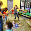 "French teacher, Veronique Carney, center, plays a game with the class at the WOW Children's Museum in Lafayette.<br /> For more photos and a video of the language class, go to  <a href=""http://www.dailycamera.com"">http://www.dailycamera.com</a><br /> Cliff Grassmick / April 25, 2012"