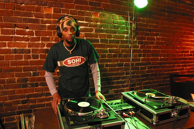 DJ Sketch sets up for the evening festivities. Charles A. Smith/Special to the Advocate