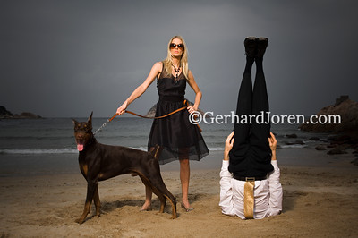 Swedish model Sofia Wallin pose with a dog, with Alexander Medin, a Norwegian yoga teacher. He perform a yoga pose (mukta hasta sirsasana), controling his breath for 5 minutes while standing on his head on Shek O Beach,  in Hong Kong.