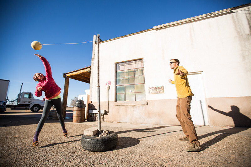 A couple playing tetherball.