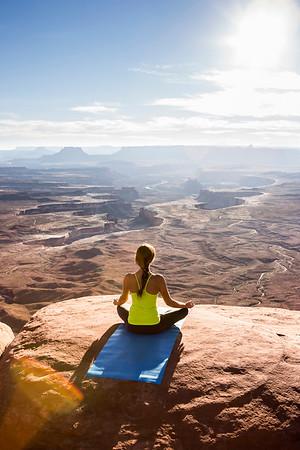 Female doing yoga and meditation outside