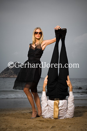 Swedish model Sofia Wallin pose with Alexander Medin, a Norwegian yoga teacher. He perform a yoga pose (mukta hasta sirsasana), controling his breath for 5 minutes while standing on his head on Shek O Beach,  in Hong Kong.