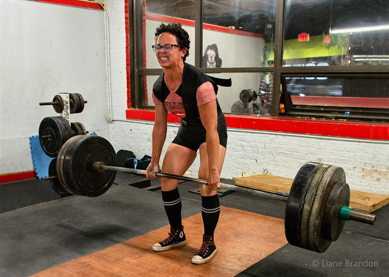 Lodrina Training<br /> Lodrina weighs 123 lbs.  She is deadlifting 365 lbs. in this photograph. <br /> Photo (c) Liane Brandon