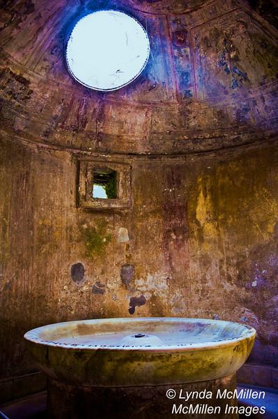 Light beam into bathhouse ruins, Pompeii, Italy.