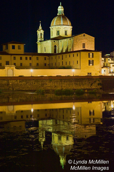 San Frediano in Cestello reflected in Arno River, Florence, Italy.